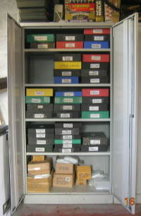 We store our figures in labelled boxfiles in large storage cabinets.